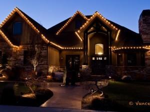 A standard Christmas light display with lights on the eaves.